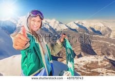 Snowboarder girl at Alps, Swiss mountain. Skier. Winter activities for good mood…