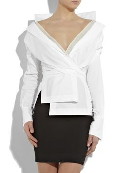 Donna Karan. This white stretch cotton-blend long-sleeve shirt has wraparound sash at waist, a notch lapel collar, a deep V-neck, a sheer cream inlay at front and neck, stitched side splits, stitched overlapping panels at front and long cuffs with concealed button fastenings. The shirt is made from 72% cotton, 23% nylon and 5% spandex ($950.00)