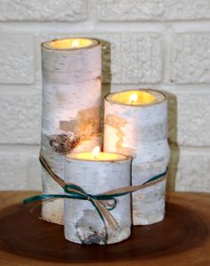 birch log candle holders... reminds me of my wedding day