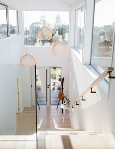 Traumhäuser Tauranga family chooses do-up over beachfront home The Peroxide Phenomenon-Gardening Mir Entry Stairs, House Stairs, Stair Lighting, Hallway Lighting, Modern Lighting, Pendant Lighting, Beachfront House, Glass Stairs, Stairs Architecture
