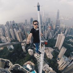 Urban Exploration VertigoInducing Examples Of Rooftopping - Daredevil duo climb hong kongs buildings capture like youve never seen