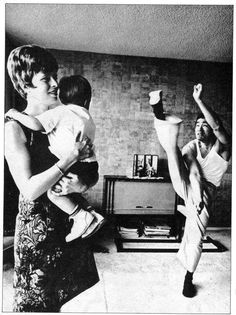 Bruce performing a high kick in front of Linda & Brandon.