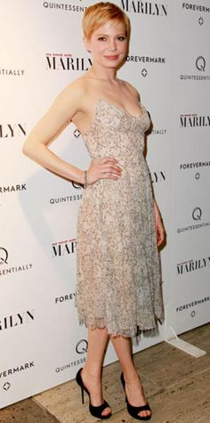 Look of the Day › November 14, 2011 WHAT SHE WORE Williams debuted My Week with Marilyn in an embroidered Erdem confection, vintage Fred Leighton diamonds and black Roger Vivier peep-toes.