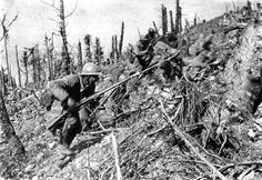 French soldiers in a bayonet charge, up a steep slope in the Argonne Forest in 1915. During the Second Battle of Champagne, 450,000 French s...