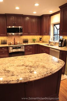Dark Cherry cabinets with granite counters