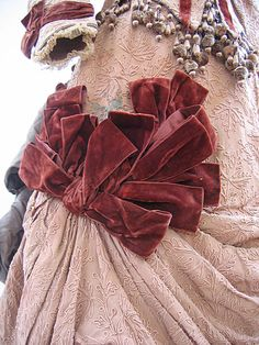 1880s - velvet ribbon made into bows at the hip