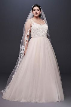 8d81a07d711d A skirt crafted of tulle, netting, and crinkle chiffon swishes below a  pearl beaded lace bodice on this classic ball gown wedding dress.