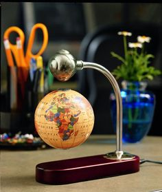 You will see some beautiful levitating gadgets which can easily make your house looking pretty. levitating gadgets have successfully appeared on the market. Earth Globe Map, World Globe Map, Map Globe, World Globes, Globe Decor, Globe Art, Cool New Gadgets, Old World Maps, Scenic Photography