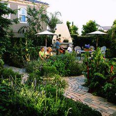 Gorgeous outdoor patio / potager / kitchen.  Love the brickwork.