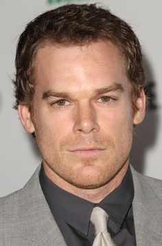 Michael C. Hall - definitely eye candy on the low.  I think it's the serial killer pout lol (on Dexter)