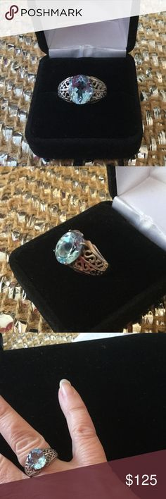 Genuine Blue Topaz Ring This ring is stunning in its simplicity !   It is a princess like Sterling silver setting.  This just speaks elegance and class.  This blue topaz is a sky Blue,  beautiful soft color ! Estate Jewelry Rings