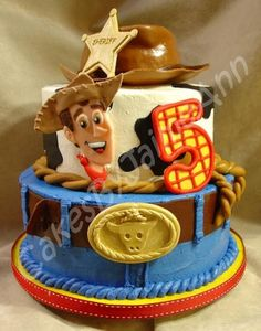 "Cowboy Birthday Cake - My friends son wanted a cowboy cake for his birthday... He loves Toy Story so looking through pictures He picked a cake done by CareyI and HAD to have that cake! ahahhaha....  This cake is a 10"" and 8"" Pineapple/Coconut scratch cake, with Pineapple/Coconut filling. Covered with Buttercream and Fondant accents, Gumpaste decorations, and the Cowboy hat was a pain in the BUTT!!!!!!!  It"