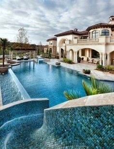 amazing pool slides for luxury homes and palm trees this is truly an outdoor paradise for the whole family the infinity pool adds a dynamic appeal to the