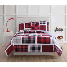 The classic pairing of red, black and white throughout the Buffalo Plaid Quilt Set from Laura Hart Kids gives this bedroom set a traditional and cozy look. The colorblock scheme on the quilt and pillow sham takes inspiration from patchwork quilts.