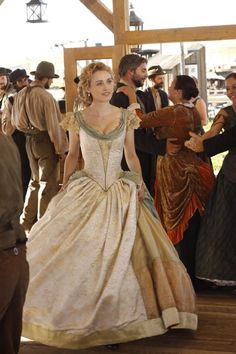 Still of Dominique McElligott in Hell on Wheels. I'm a bit skeptical of its historical correctness (the bust emphasis is a little too Regency), but it's a beautiful dress.