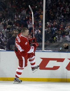 Detroit's Tomas Holmstrom celebrates his winning goal in the overtime shootout in the second game at the Alumni Showdown between the Detroit Red Wings and Toronto Maple Leafs at Comerica Park.