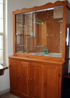 Great indoor unit cabinet turned bird aviary! I'd like 2 of these, one ...