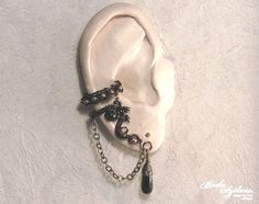 BLACK and BRONZE  wire wrapped gothic ear cuff by bodaszilvia, $21.50