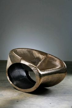 Ron Arad has created many innovative objects, some of his furniture can receive SMS messges and display them as well.