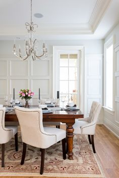 Bright Wall Paneling trend Toronto Traditional Dining Room Innovative Designs with dining chandelier dining room chairs extension table nailhead trim dining chairs rectangular dining table