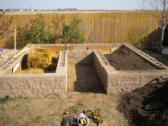 Raised bed vegetable garden using decorative concrete block.