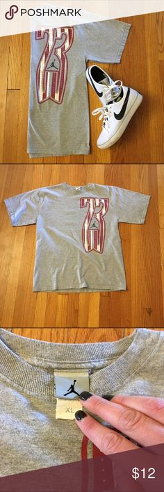Vintage Jordan T-Shirt Vintage grey Jordan t-shirt with stretched out 23 design on front. In excellent vintage condition: soft and worn-in for you but no stains, holes, or flaws. Marked size XL but I think it would work fine on a L or XL and could even work for a M if you want a super oversized look. Check out the rest of my closet and bundle to save 15% and only pay one shipping fee! Jordan Tops Tees - Short Sleeve