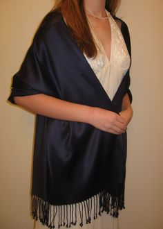 Top of the Line Pashmina Shawls rock at $32.00 each silk pashmina shawls make the best evening shawls for your evening dresses and gown. I wear them and get compliments. Evening Pashminas in many colors is a must have for your wardrobe or as a gift for women..
