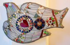 Floral Mosaic Bird made using the medium of mosaic. This mosaic bird is made using hand cut stained glass, some iridescent, with vintage china