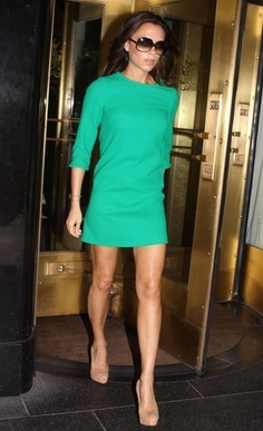 Victoria Beckham looks so beautiful wearing a green shirt dress, nude high heels and her signature large sunglasses <3<3 Love her look ;)