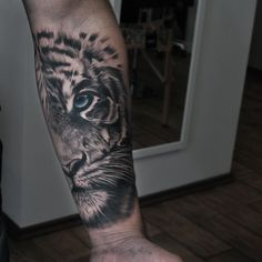 Freshly done, black and gray tiger with blue eye. Artist John Logan #tiger #tigertattoo #tattoo #animal #animaltattoo #nature #wildlife #tigerface #halffacetiger #blueeye #armtattoo #halfsleeve #riga #tattooinriga #tattooed #art #tattooink #ink #inked #skin #tattooartist #tattoofrequency #share #like #follow