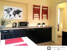 Decorating project for Airbnb apartment in Prague, Czech Republic #kitchen #red #chair #black #ikea #prague #wallpaper