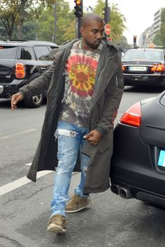 Kanye West in distressed Levi's 514s.
