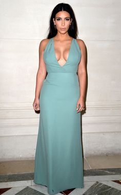 Kim Kardashian looks amazing in a plunging blue Valentino gown!
