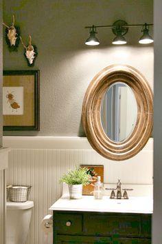 Our Pullman Bath Light in bronze on Holly Mathis Interiors... http://www.hollymathisinteriors.com/2013/11/little-boys-bathroom/