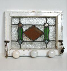 Hallway/front door organizer made from old stain glass window, hooks and door knobs.