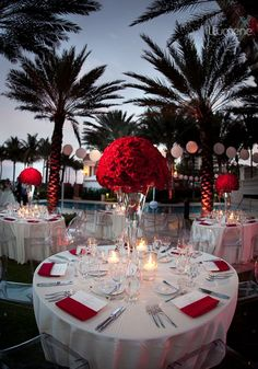 #red wedding tables ... I like the red napkins with the red flowers