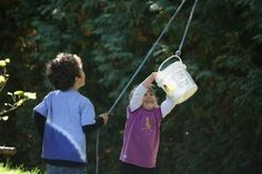 a bucket and a rope- pulley for outdoor play