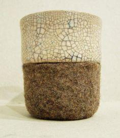 Ceramic mug with felt sleeve by Tumar Art Group.