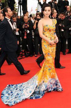 Fan Bingbing - Breathtaking oriental dress. She's wearing Laurence Hsu gown and Cartier earrings in Cannes