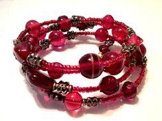 Free domestic shipping! Red beaded cuff bracelet by barefootcreekjewelry on Etsy. #giftsforher #christmasjewelry