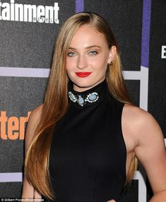 Pure elegance: Sophie Turner, who plays Sansa Stark, added some colour to her look with bright red lipstick