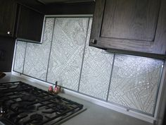 Prairie Glass Studio - Custom backsplash made entirely from clear glass. It's loaded full of texture and installed flat side facing out to make it easy to clean #gallery #glass #art #kitchen #remodel #backspash #home