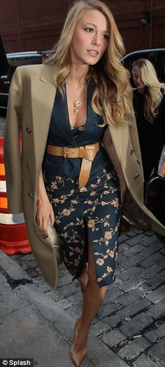 Blake Lively is so put together in this navy and tan ensemble. She energizes an old-fashioned look with a plunging neckline and front slit.
