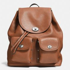 Coach Turnlock Tie Rucksack (645 CAD) ❤ liked on Polyvore featuring bags, backpacks, brown, leather backpack bag, brown leather bag, coach bags, leather bags and brown bag