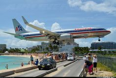 American Airlines N936AN Boeing 737-823 aircraft picture..St. Martin...we would stand on the wall on the beach & welcome our next crew to the layover...good ole days!!