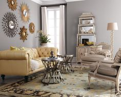 Beautiful grey and yellow living room. Love the tables!