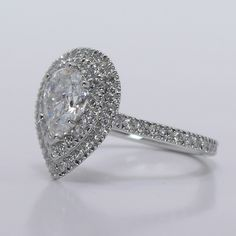 The Pear-Cut Diamond is encircled by a double halo of pave diamonds, which make the stone appear a lot larger in size.