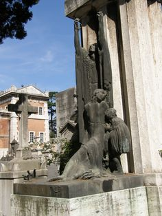 Rome - Verano cemetery... tomb of Wania Ciolfi ( 1910-22) with hands of death that come out to get her