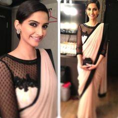 Stylish simple cream & black saree.. Beautifully worn by Sonam Kapoor