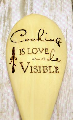 """Hand burned wooden spoon with Cooking is Love Made Visible design.  This is a restaurant quality 12"""" wooden spoon. Sanded smooth and hand burned for use as both a working kitchen tool and a decorative home accent. We tested many brands of spoons before ..."""